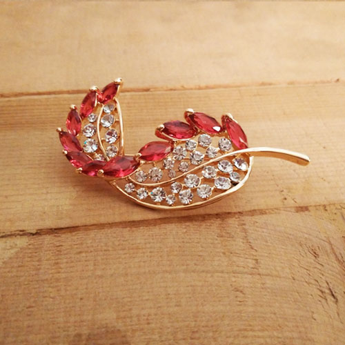 red-feather-brooch